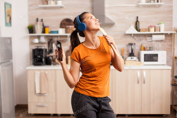 Dancing and singing in the kitchen