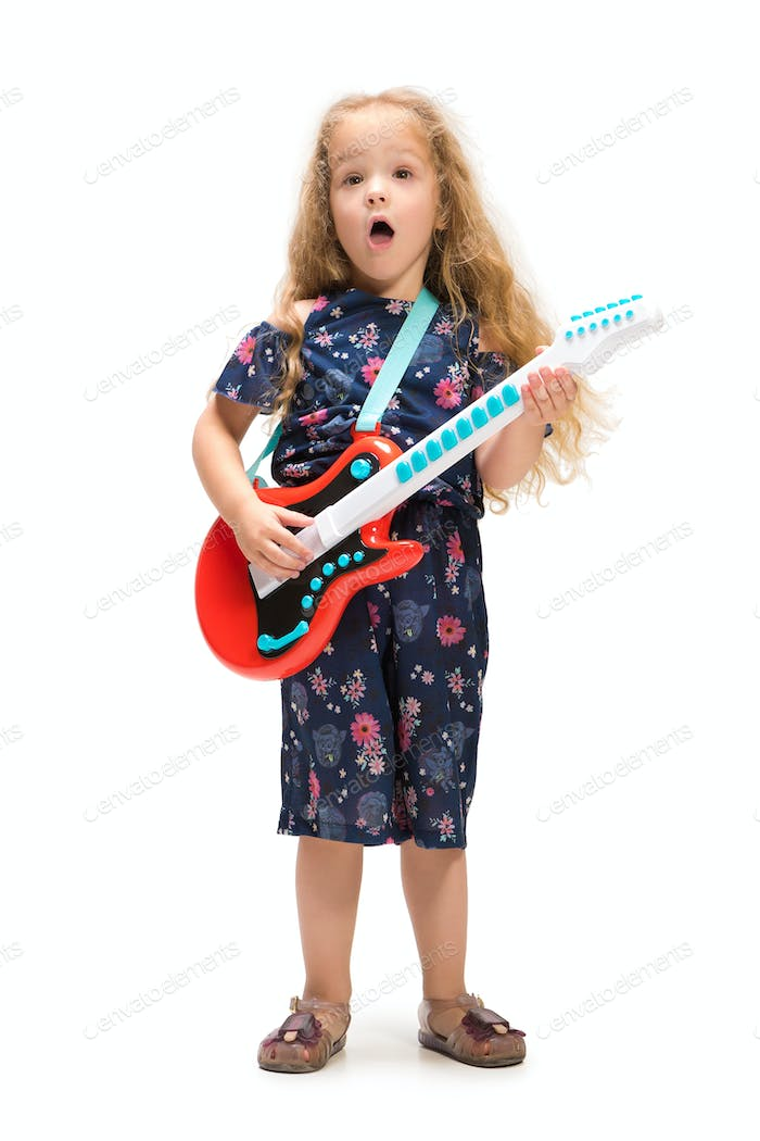 Smiling cute toddler girl three years singing over white background