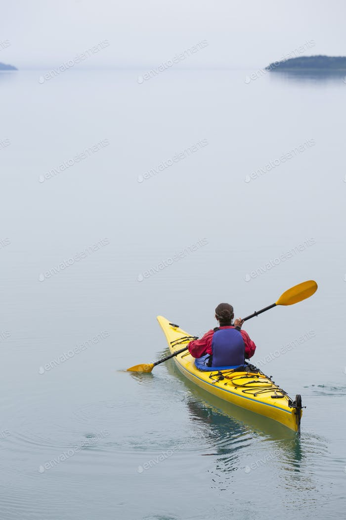 Female sea kayaker paddling