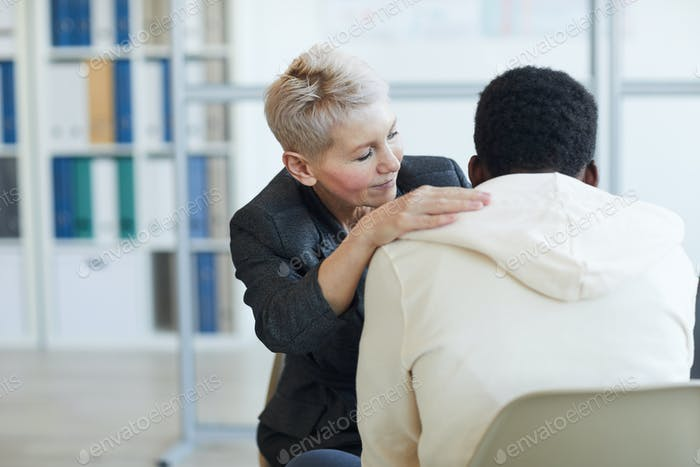Mature Psychologist Helping Grieving Man