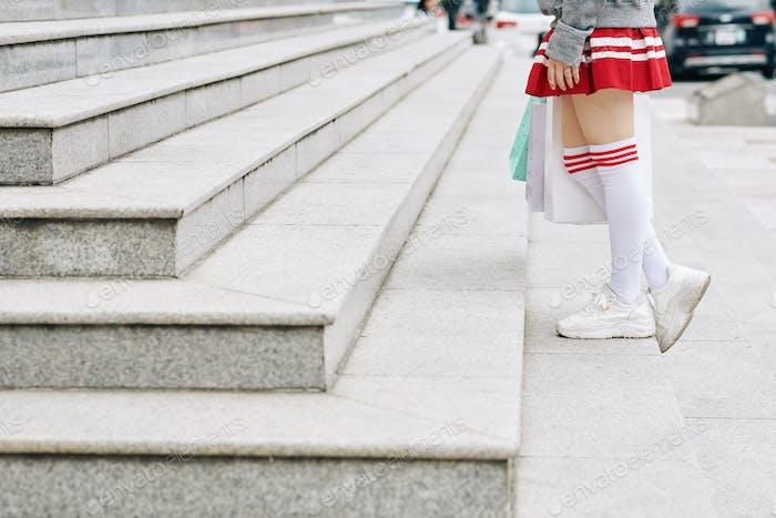 Schoolgirl in thigh high socks