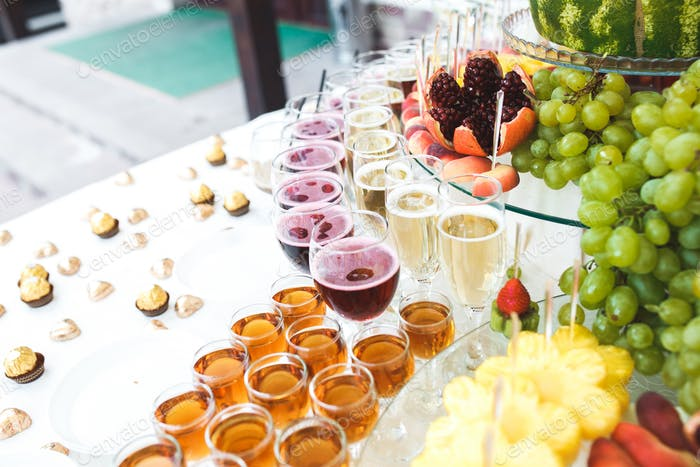 rich buffet, whiskey, bourbon, champagne, wine and fruit.
