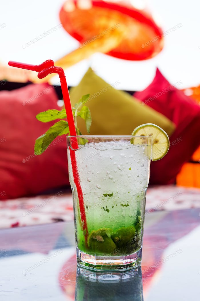 Refreshing summer mojito cocktail in a glass