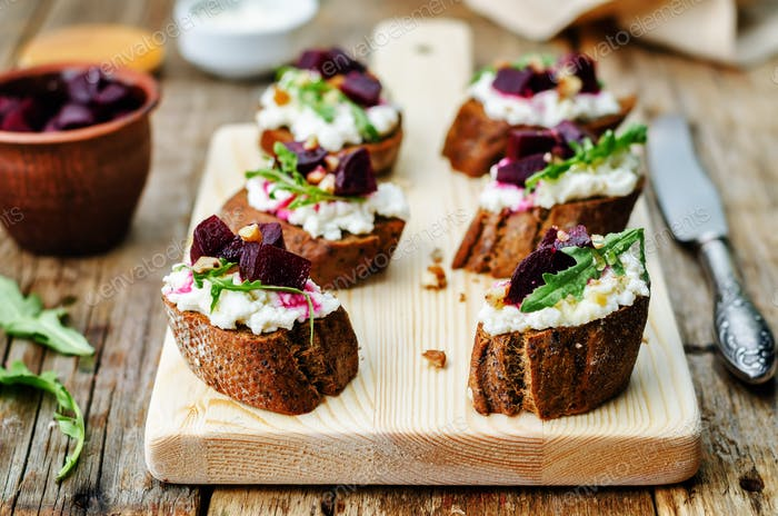 beet goat cheese arugula walnut honey crostini