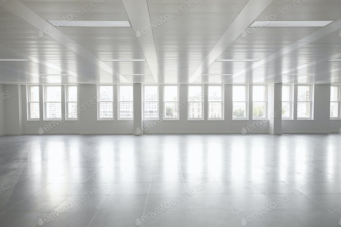 Vacant open plan office space with windows