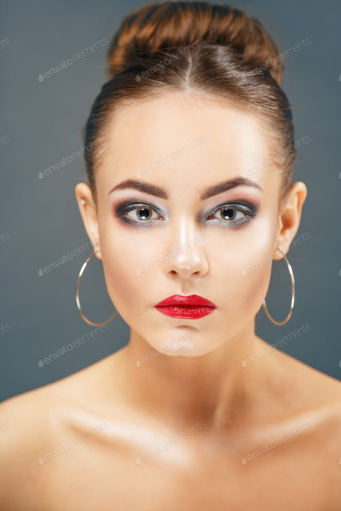 Beautiful young woman portrait with big earrings