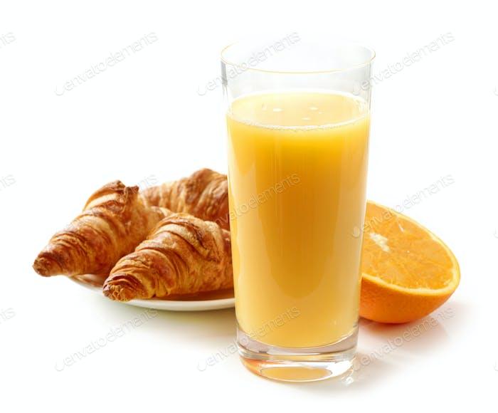 glass of orange juice and croissants