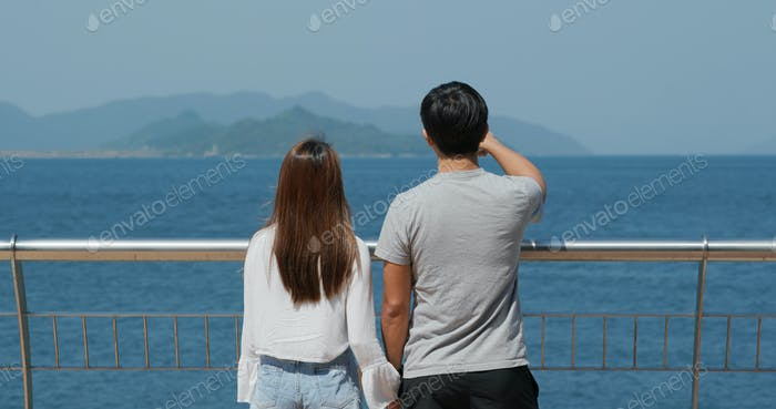 Couple look at the sea together