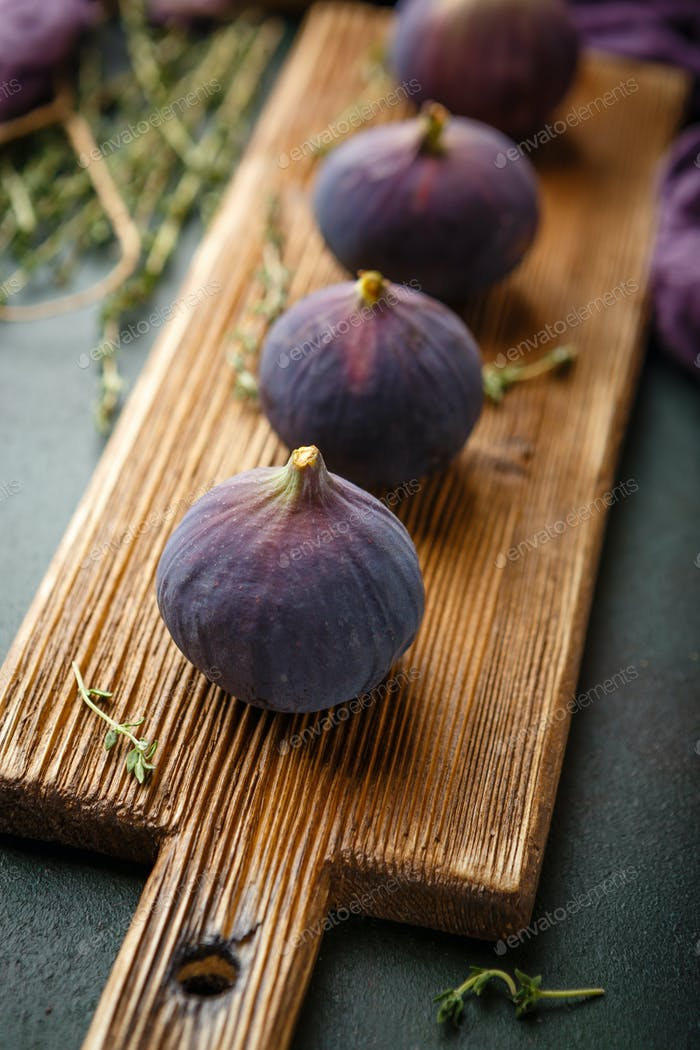 Juicy fig fruits on a dark background