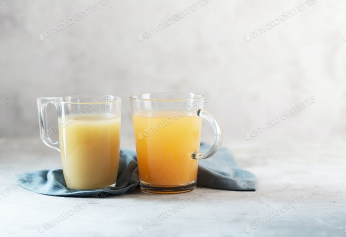 Glasses with Homemade Beef Bone Broth on a gray background with copy space