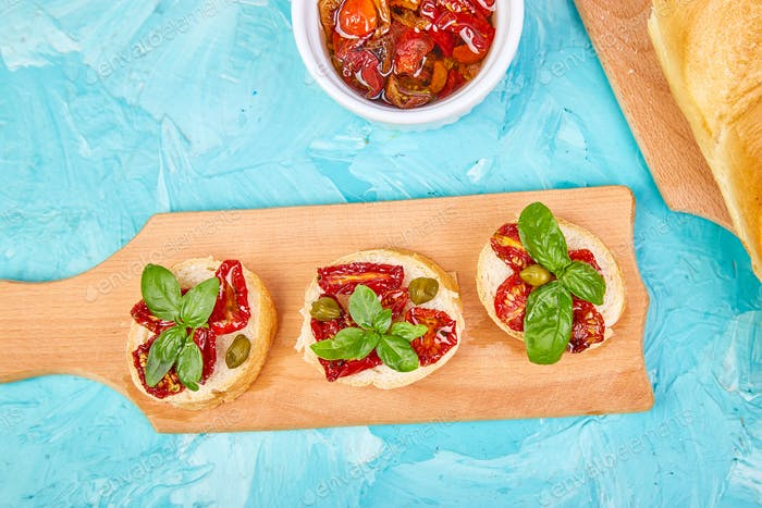 Bruschetta or crostini with sun dried tomatoes and capers