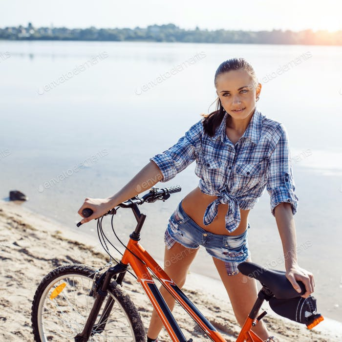 woman on a bicycle in beach