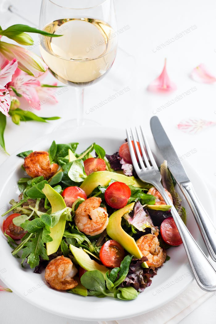 Avocado shrimp salad with cherry tomatoes