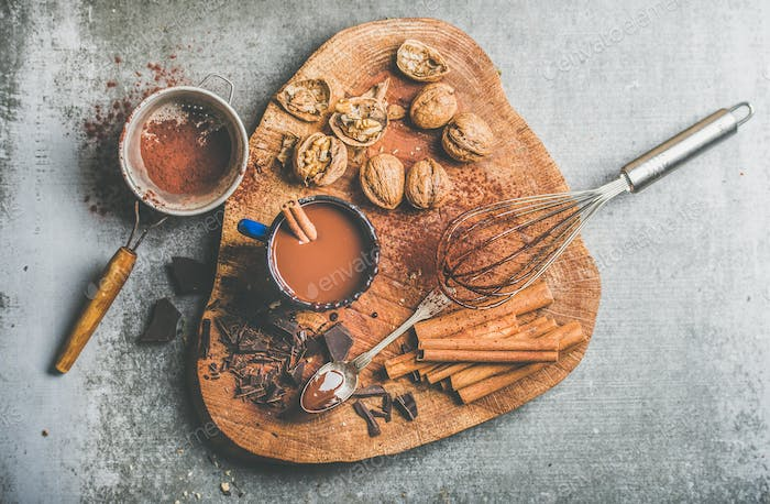 Rich hot chocolate with cinnamon and walnuts, top view
