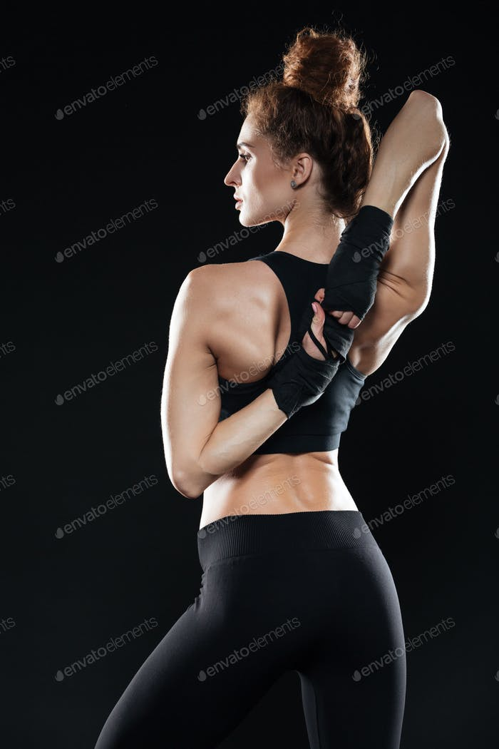 Vertical image of female fighter warming up
