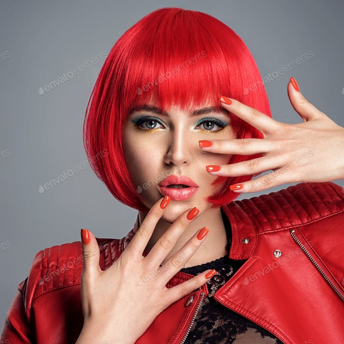 Beautiful woman with bright red nails.  Portrait of an attractiv