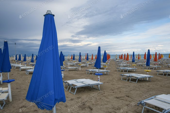 Beach resort with sun beds and beach umbrellas