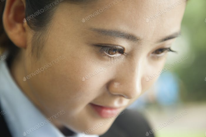 Young businesswoman's face, portrait