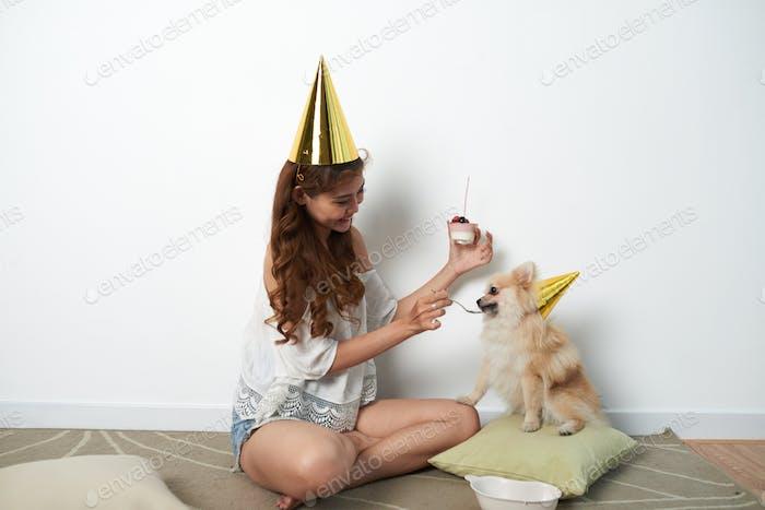 Feeding with birthday cake