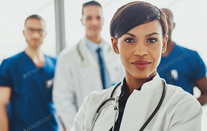 Female doctor in front of team