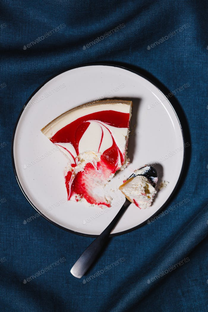 Creative minimalist food photography, strawberry cheesecake on a white plate