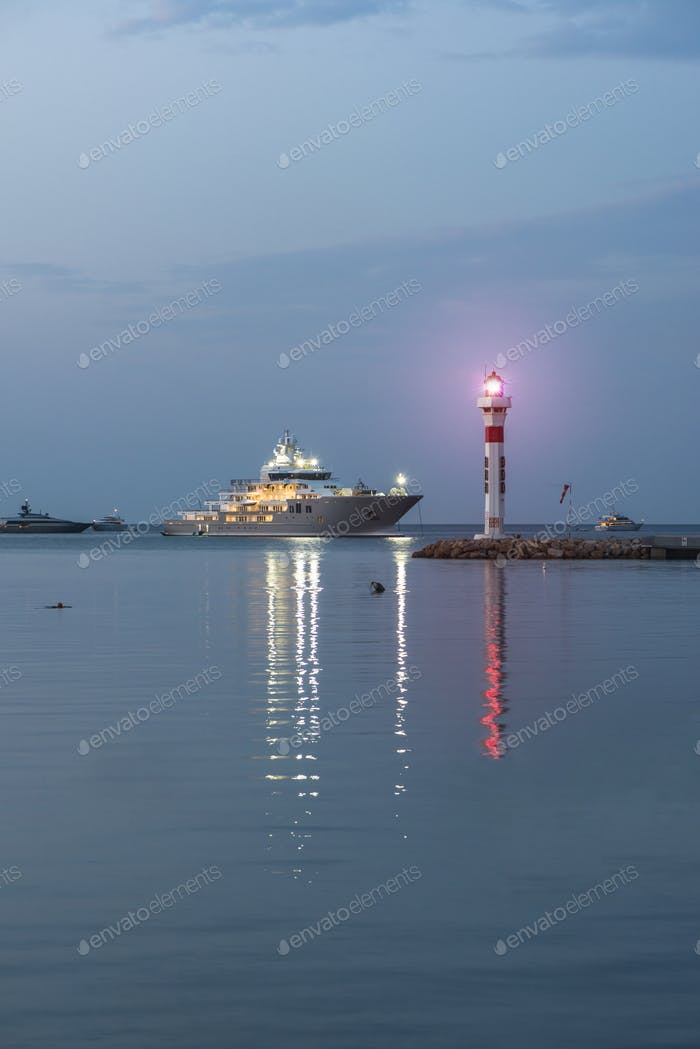 Yachts and lighthouse in Cannes