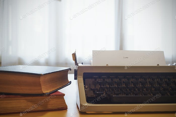 Vintage typewriter on  wooden table