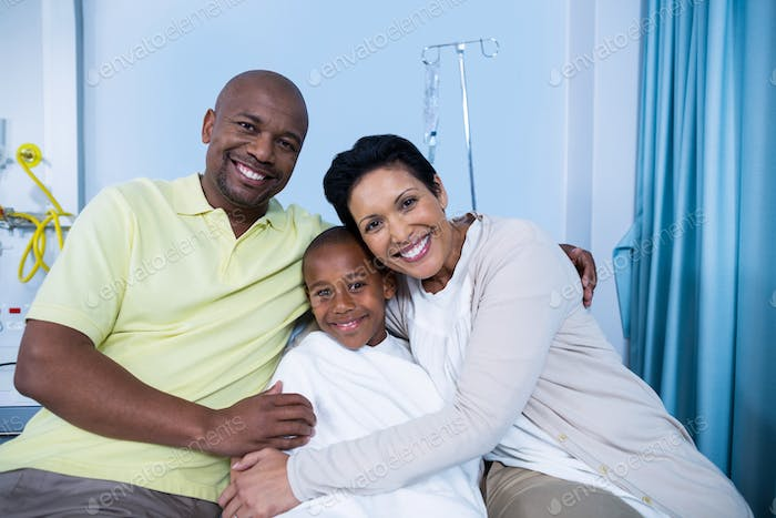 Portrait of smiling parents and patient