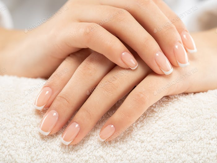 Woman gets manicure procedure in a spa salon. Beautiful female h
