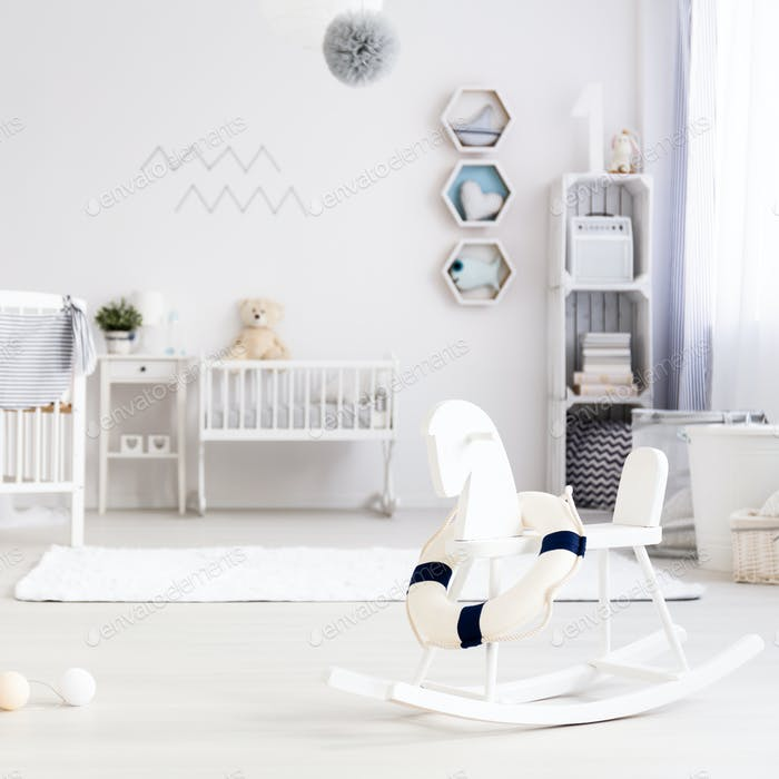 Light baby room with rocking horse