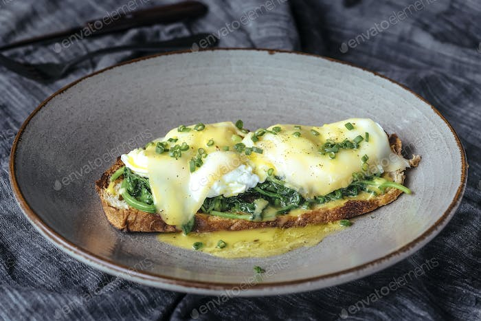 Eggs benedicts on toast, close up view.