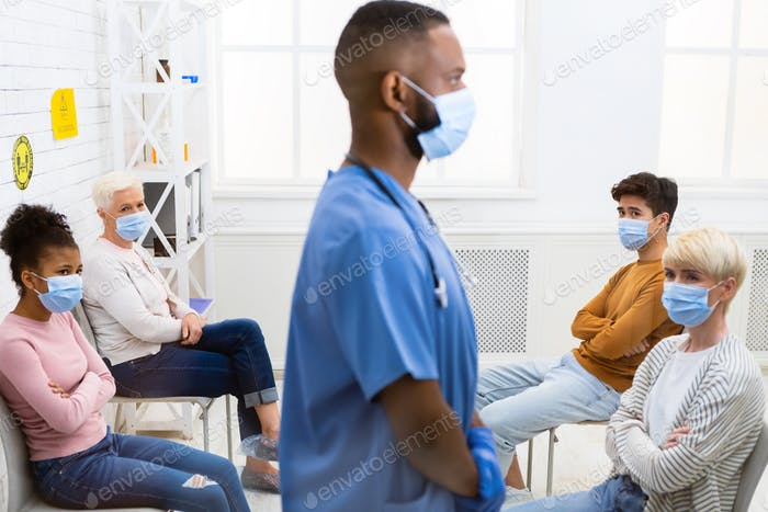 Sick Patients Looking At Doctor Waiting For Appointment In Hospital