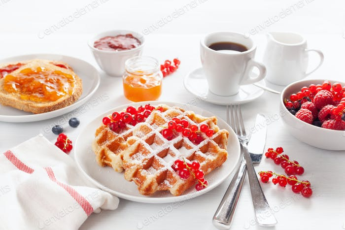 breakfast with waffle, toast, berry, jam, chocolate spread and c
