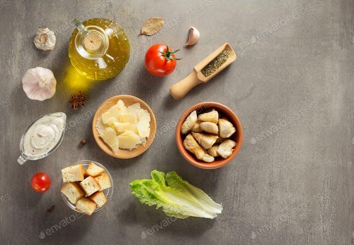caesar salad ingredients at stone  table