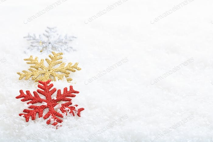 Snow flakes on snow background
