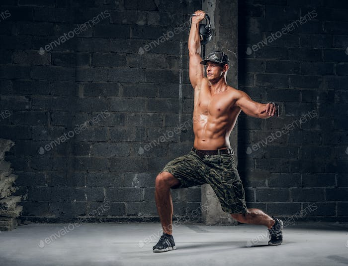 Sportive man is doing exercises with dumbbell