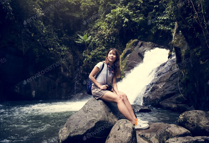 Asian woman enjoying an outdoor trip
