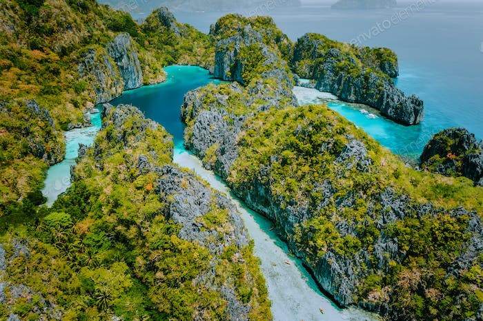 Aerial drone view beautiful shallow tropical Big and Small Lagoon explored inside by tourist on