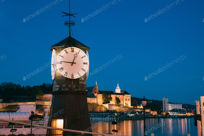Oslo. Norway. Old Clock at Aker Brygge In Oslo Embankment, Norway. Night View Of Famous And Popular