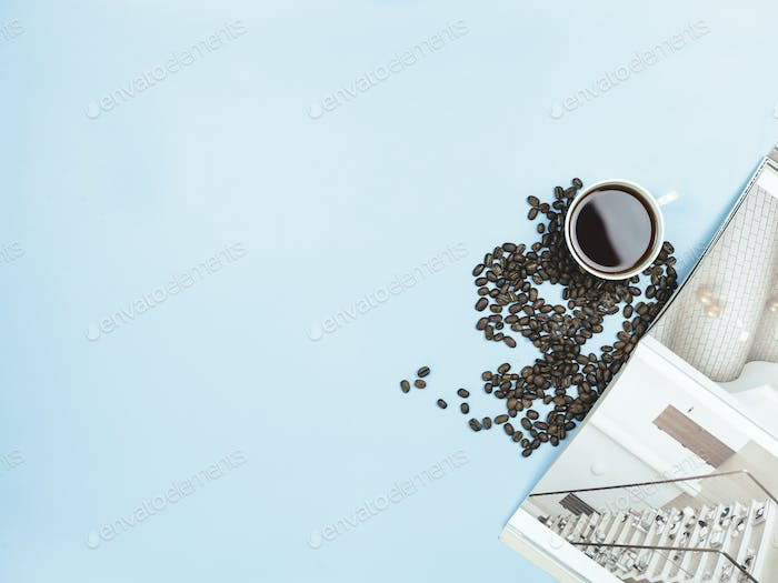 top view black coffee and books on blue background
