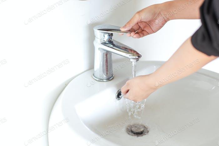 Washing hand on sink