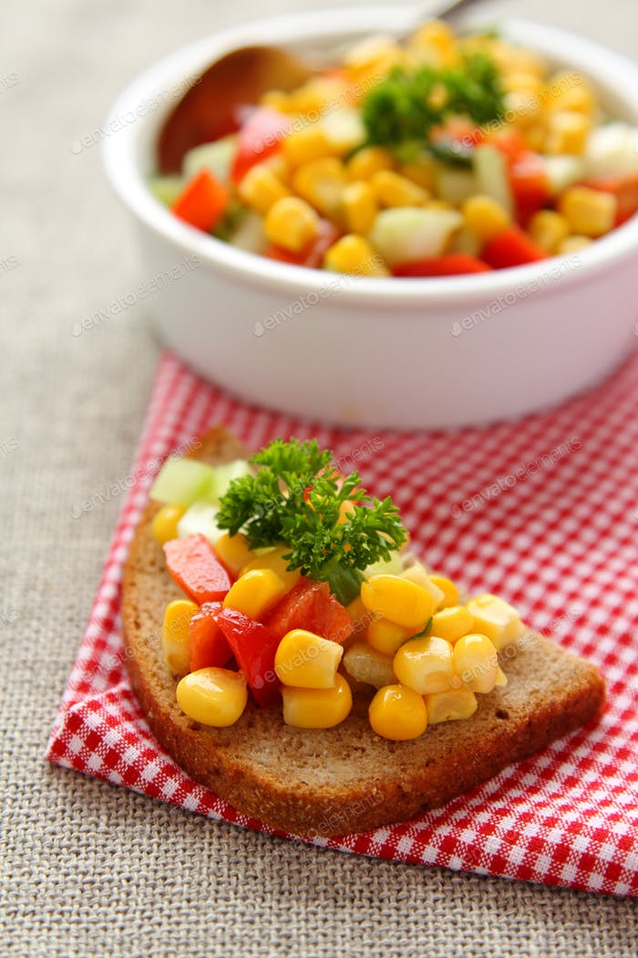 Sliced rye bread with homemade corn salsa
