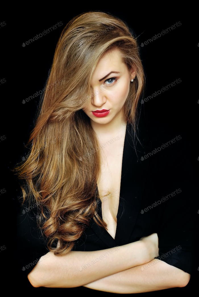 Beautiful young woman with on a black background