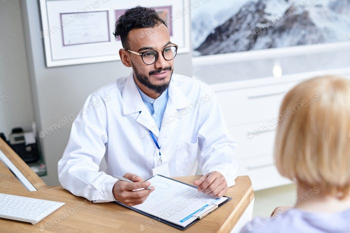 Middle-Eastern Doctor Consulting Patient