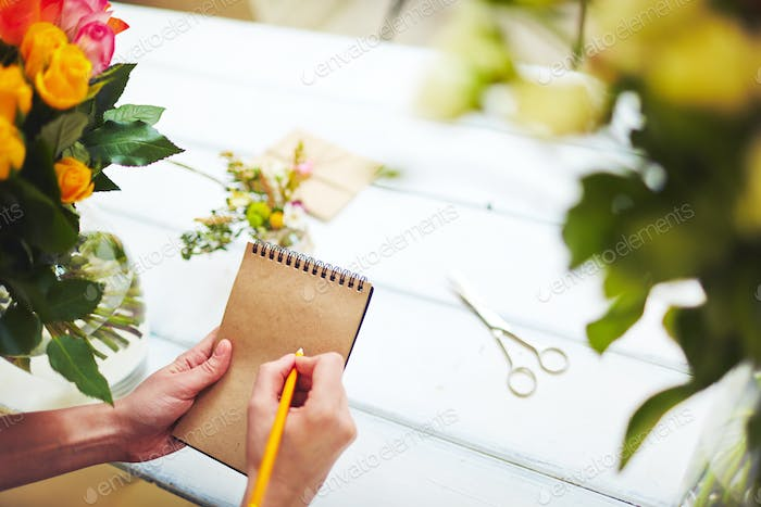 Florist with notepad