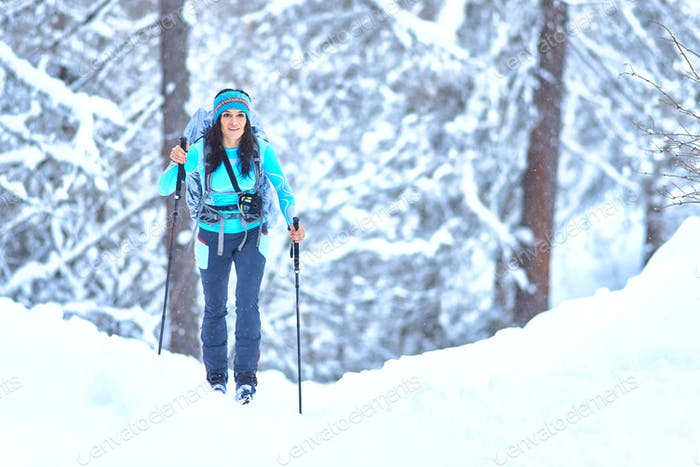 Young woman practicing ski touring during