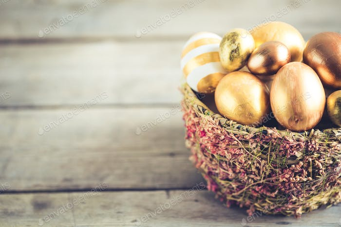 easter eggs colored with golden paint in differen patterns. Copy space