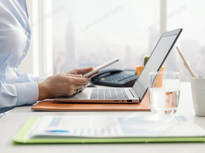 Corporate businesswoman using a digital tablet