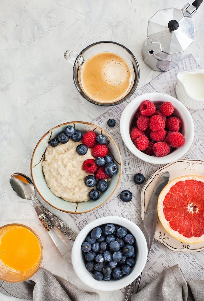 Healthy breakfast table with oatmeal porridge,  fresh berries an