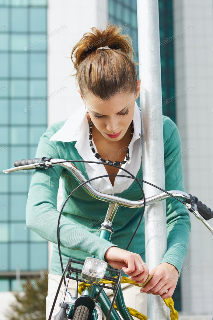 Young Business Woman Going To Work By Bike